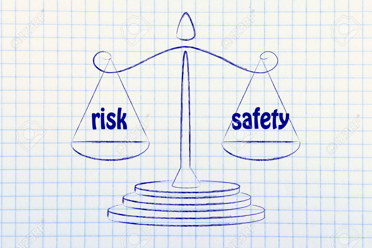 concept of comparing risk & safety, illustration of an old school balance